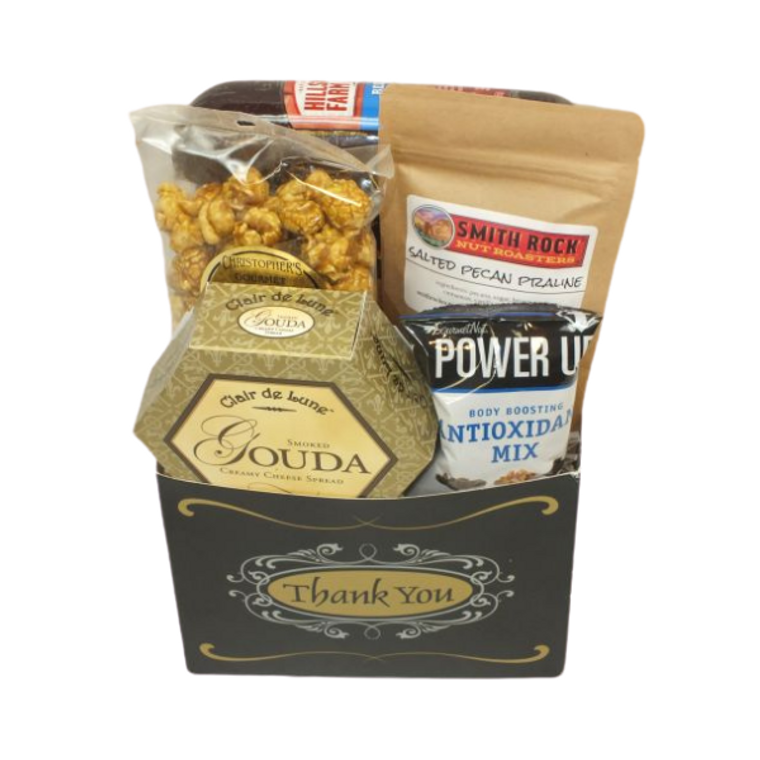 Thank You Sausage & Cheese Basket includes Three Pepper Crackers, Beef Summer Sausage, Gouda Cheese Spread, Toffee popcorn, Sweet Whisky Almonds, Energy pack of nuts and dried fruit.