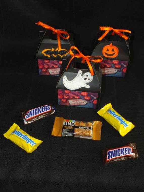 Happy Halloween Mini Gift includes 4 mini Halloween candy bars and a mini Kind bar.  Need to purchase a large order call 541-977-1036.  We can add your logo on the back side of gift for no additional fee.