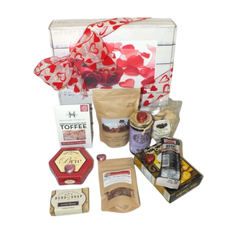 Valentine's Oregon Savory Gift Box -  Includes Summer Sausage 5oz., Marionberry Jelly, Bend Soap Company Sweet Orange goat milk soap, Smith Rock Coffee Roaster Misery Ridge Blend (small batch roast), Smith Rock Nut Roasters Salted Pecan Praline, McTavish Bakery Chocolate chip shortbread cookies, Brie Cheese Spread, three pepper Crackers, Sea Salt chocolate toffee. Designed in recyclable Valentine's Day Themed gift box and with hand made bow.