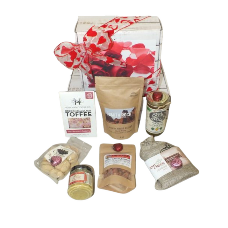 Valentine's Taste of Oregon Gift Box includes White Chocolate Raspberry Toffee, Smith Rock Coffee - Misery Ridge Blend, Sweet Whisky Almonds, Chocolate chip shortbread cookies, Aioli garlic mustard and Ash Creek Dark Chocolate Oregon Hazelnuts all products are made in Oregon  Designed in a Valentine's themed Gift Box.