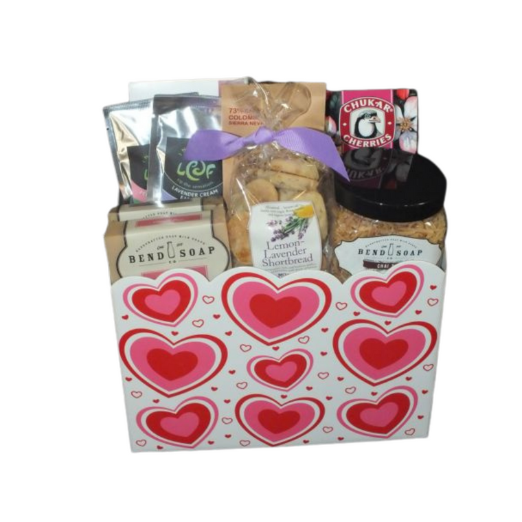 Valentine's Day Spa Basket includes:  Luxury Milk Bath, Two bars of Goats Milk Soap (Lavender Blossoms, Vienna Rose, Coconut Island Goats Milk Hand Lotion,   2 Packages of Loose Leaf Tea, Wafer Cookies, Gourmet cookies, Chukar Cherries White & Dark Chocolate Cherry Blossoms, Lavender Shortbread Cookies and Black Sheep Chocolate (made in Bend. .Designed a fun Valentine's Day Container with handmade bow