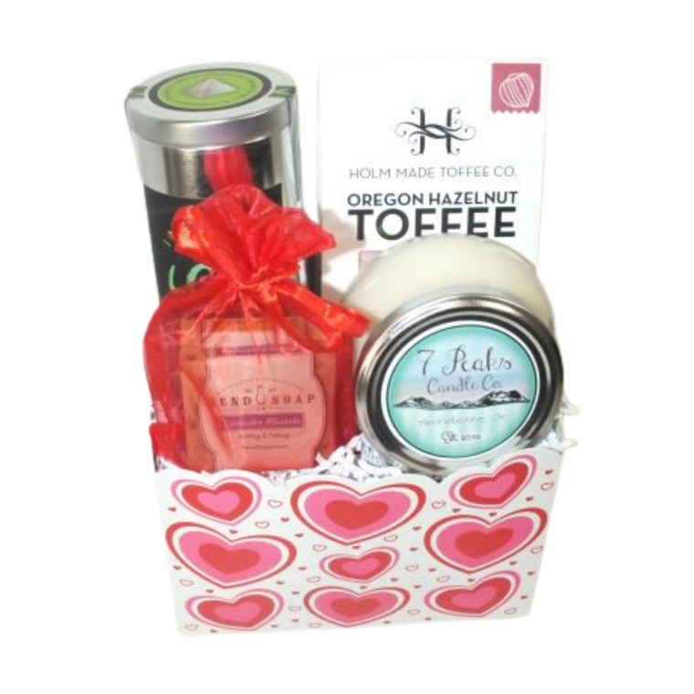 Valentine's Day Oregon Spa Gift Set includes  Holm Made Toffee Company   White Chocolate Raspberry Toffee, Inspired Leaf Tea Tin, Bend Soap Company Lavender soap bar, Sweet Orange Soap Bar, Seven Peaks Candle Company (Terrebonne, Or) Island Romance Scent (note of Orchid flower, sea salt and Jasmine.  Designed in a fun Valentine's container with handmade bow.