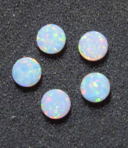 Opal dots OP17 9.5 x 1.3mm flat pcs made to specific diameter and thickness made from manufactured opal suitable for inlay, fretboard markers, jewellery, Opal dots can be worked same way as mother of pearl and are of similar hardness.