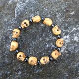 Skull Bracelet of Bone and Hematite, 11 Carved Bone Skulls and 11 Round Hematite Beads, Stretch Cord