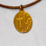 Mary Medal in Gold on Brown Leather