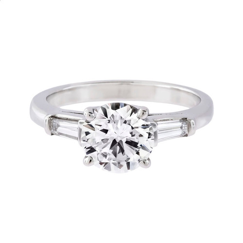 Engagement Ring with Brilliant Cut Diamond and Baguettes