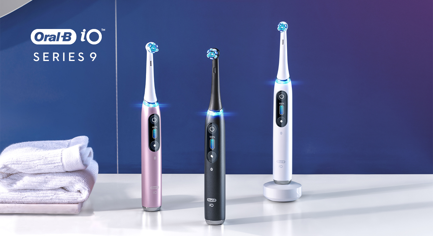 Oral-B iO Series 9 electric toothbrush collection on white marble counter