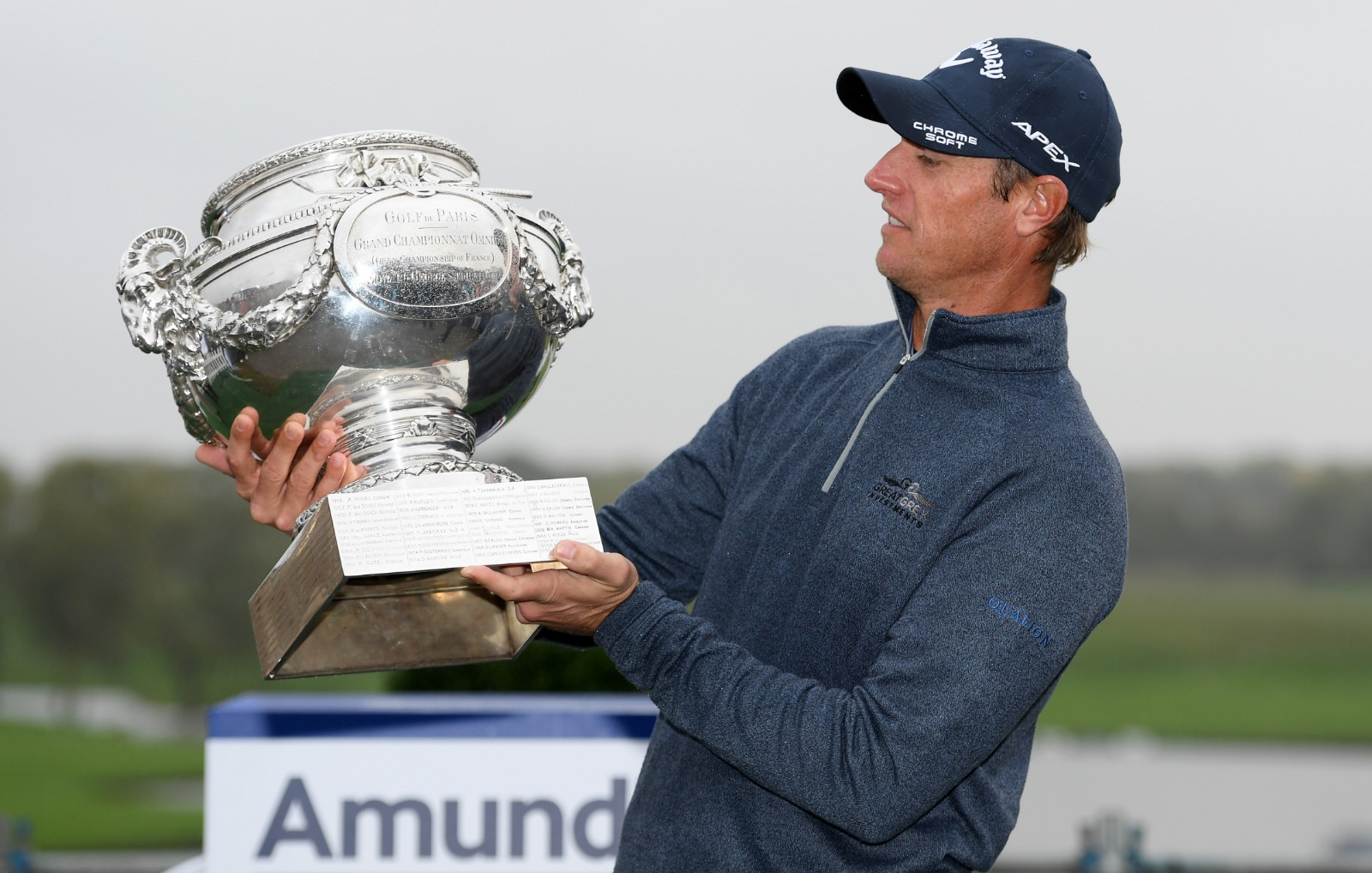 Dunning staff player Nicolas Colsaerts holding trophy after win