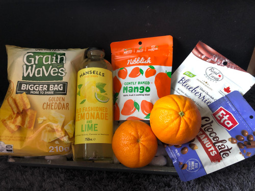 This basket is a great mix of fruit and other nibbles.   Included in this basket are Lemonade and key lime concentrate, Mango slices , chocolate blueberries, Chocolate peanuts, Grapes or oranges, or mixed fruit ( You can pick otherwise what is pictured will be sent) and Grain waves.