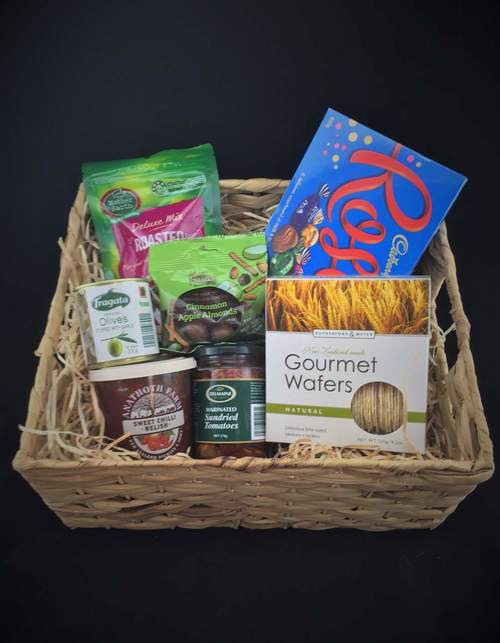 This basket is a nice mixed gift. Includes Mother earth mixed roast nuts, A box of gourmet wafers, Fragata garlic stuff olives, Anathoth sweet Chili relish , Delmaine sun-dried tomatoes, Apple and cinnamon  almonds and aLarge box of roses chocolates