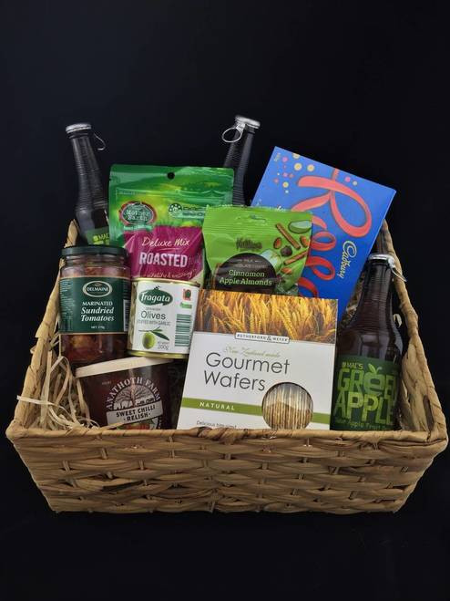 This large gift basket includes This gift basket includes  Mother earth mixed roast nuts, A box of gourmet wafers,,Fragata garlic stuff olives, Anathoth sweet Chili relish, Delmaine sun-dried tomatoes, Apple and cinnamon almonds, Large box of roses chocolates and a Mac soft drink