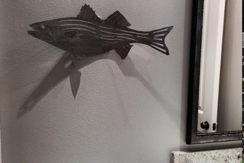 Striped bass fish sculpture