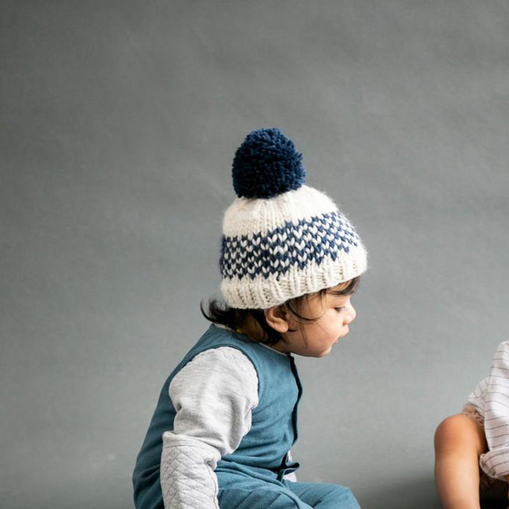 The Blueberry Hill Fair Isle Stripe Hat with Fur Pom Pom - Denim Blue