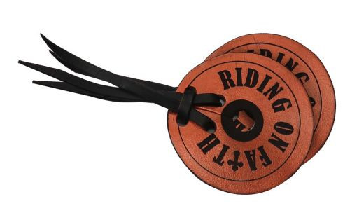 "Metallic copper leather bit guards with "" Riding on Faith""."