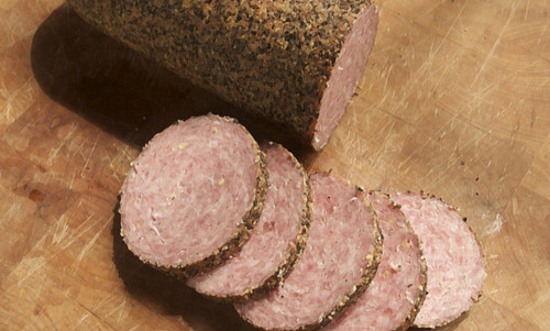 Quality old fashion summer sausage covered in a black pepper casing