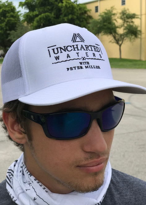 Uncharted Waters with Peter Miller in this official Mesh Trucker Hat in White
