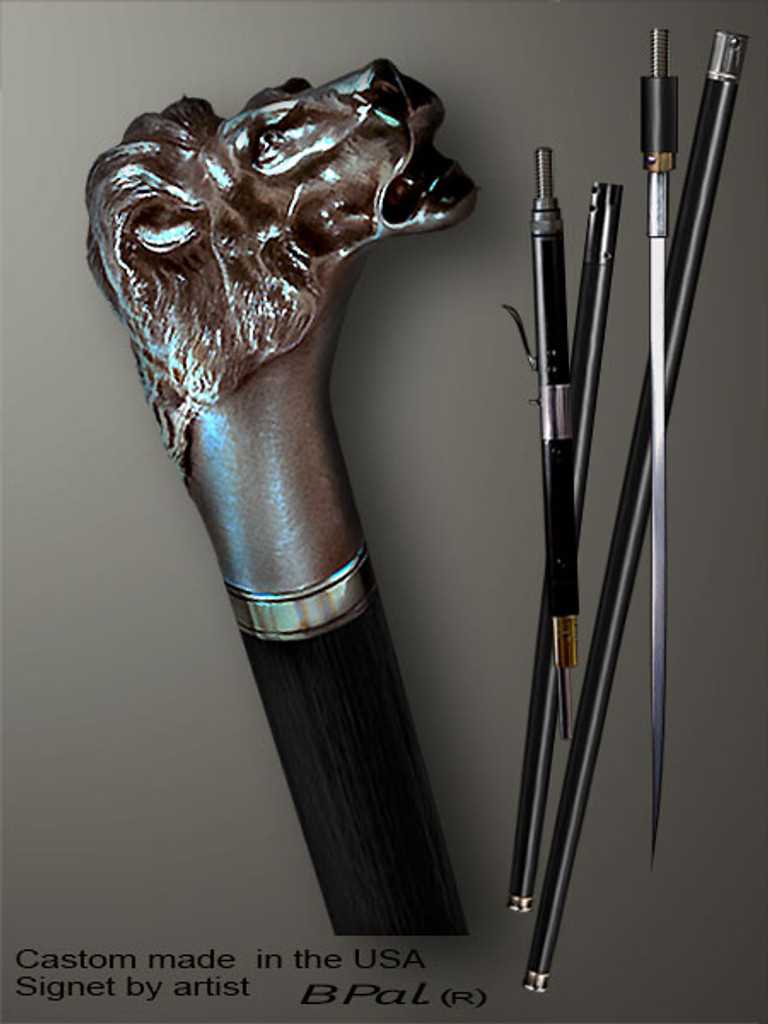 Handmade walking cane Lion head is created and produced in the USA. Unique walking sticks handle is cast from sterling silver and mounted on the ebony or rosewood shaft. Custom version can be finished with natural gems. Somebody using a walking stick might want not only physical support, but also some level of collectible or self-defense value. That is why a support walking canes can be done as a sword cane or cane gun. In this case high quality knife or air gun shooting mechanism will be built into the shaft as shown on the picture.