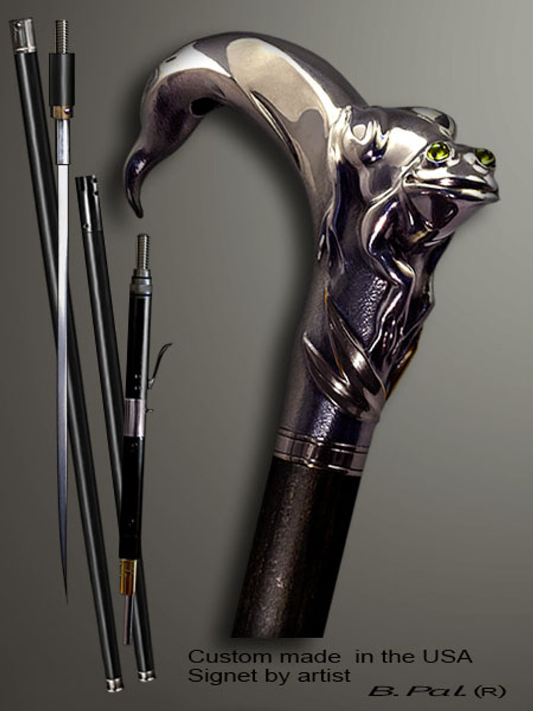 Designer walking cane Frog is created and produced in the USA. Somebody using a walking stick might want not only physical support, but also some level of collectible or self-defense value. That is why a support walking canes can be done as a sword cane or cane gun. In this case high quality knife or air gun shooting mechanism will be built into the shaft as shown on the picture. Handmade walking sticks handle is cast from sterling silver mounted on the ebony or rosewood shaft.