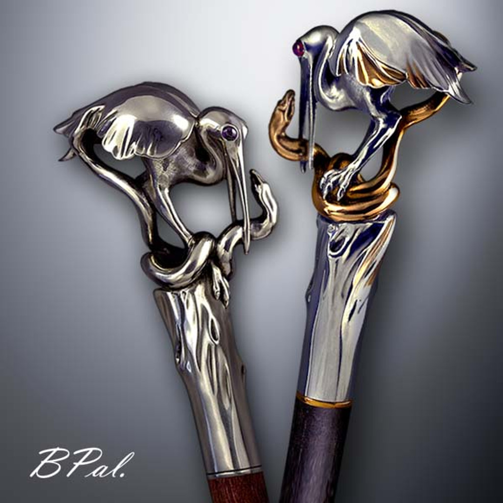 Exclusive walking cane Heron and Snake design is created and produced in the USA. Handmade walking canes handles are cast from Sterling silver or Bronze and mounted on an exotic wood shaft. The luxury walking canes version will be completed with 24K Gold plating trim and natural gems by customer request. Somebody using a walking stick might want not only physical support, but also some level of decorative and aesthetic value. Nevertheless, while considering the aesthetics of the walking cane it is important to remember that the comfort, physical stability and security of the walking canes should also be given priority. Functional and decorative walking canes can be requested as a beautiful anniversary gift.