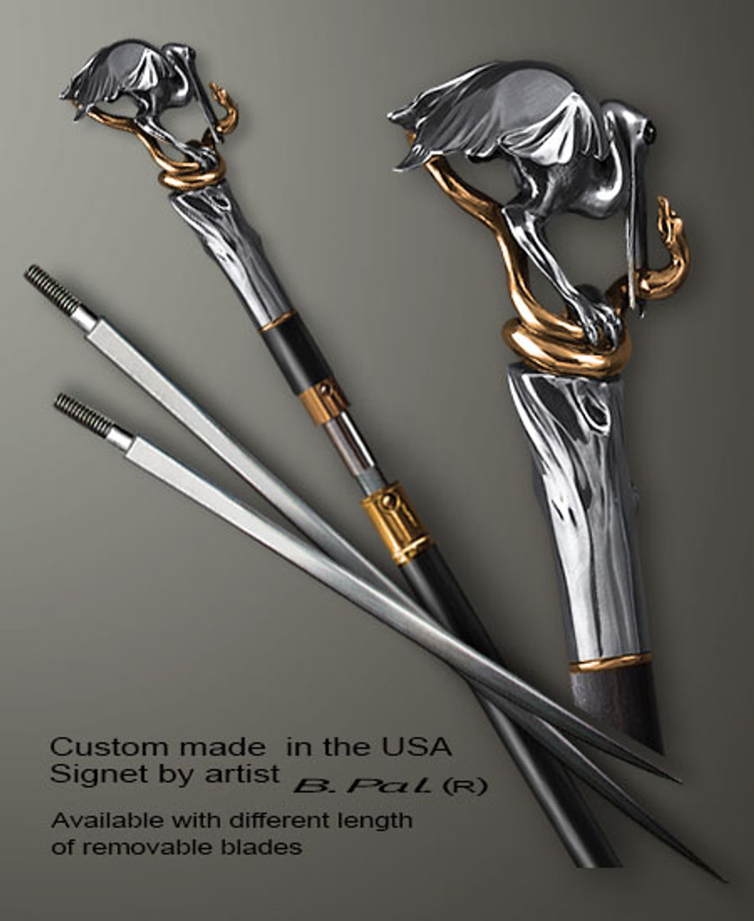 "Sterling silver with gold trim custom made walking stick Heron and snake in sword cane version. Some regional laws prohibit the use of sword canes. That is why these sword canes are designed with removable blades. This way you can keep it as a sword cane in your collection or use it as a regular support walking cane. The sword cane can be completed with 12"" or 16"" blade by customer request."