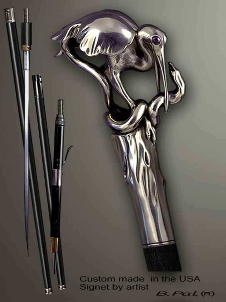 Designer walking cane Heron and snake is created and produced in the USA. Somebody using a walking stick might want not only physical support, but also some level of collectible or self-defense value. That is why a support walking canes can be done as a sword cane or cane gun. In this case high quality knife or air gun shooting mechanism will be built into the shaft as shown on the picture. Walking sticks handle is cast from sterling silver mounted on the ebony or rosewood shaft.