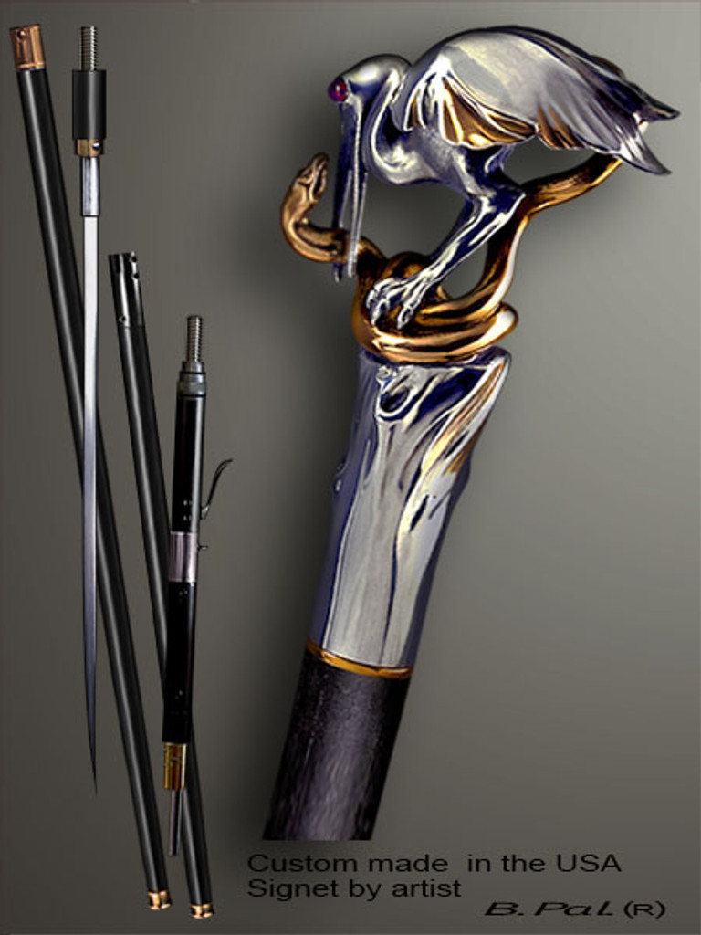 Artistic walking cane Heron and snake is created and produced in the USA. Somebody using a walking stick might want not only physical support, but also some level of collectible or self-defense value. That is why a support walking canes can be done as a sword cane or cane gun. In this case high quality knife or air gun shooting mechanism will be built into the shaft as shown on the picture. Handmade walking sticks handle is cast from sterling silver mounted on the ebony. Custom version can be finished with 24K Gold trim.