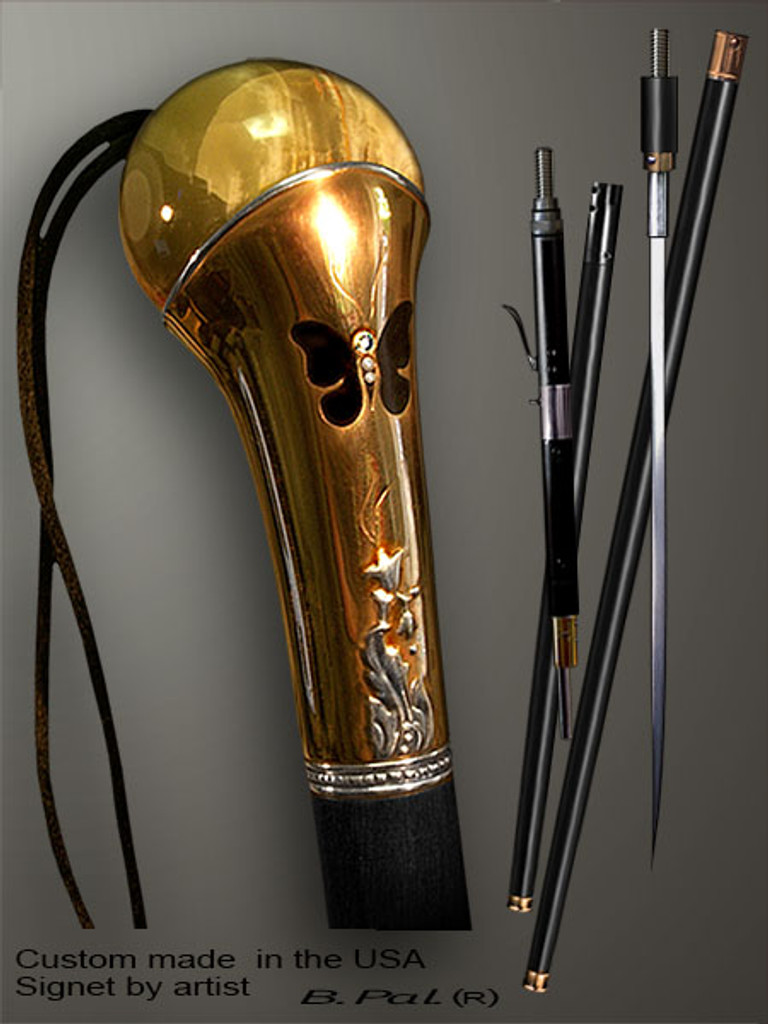 Unique walking cane Butterfly is created and produced in the USA. Artistic walking sticks handle is cast from sterling silver and mounted on the ebony shaft. Custom version can be finished with 24K Gold trim and natural gems. Somebody using a walking stick might want not only physical support, but also some level of collectible or self-defense value. That is why a support walking canes can be done as a sword cane or cane gun. In this case high quality knife or air gun shooting mechanism will be built into the shaft as shown on the picture.