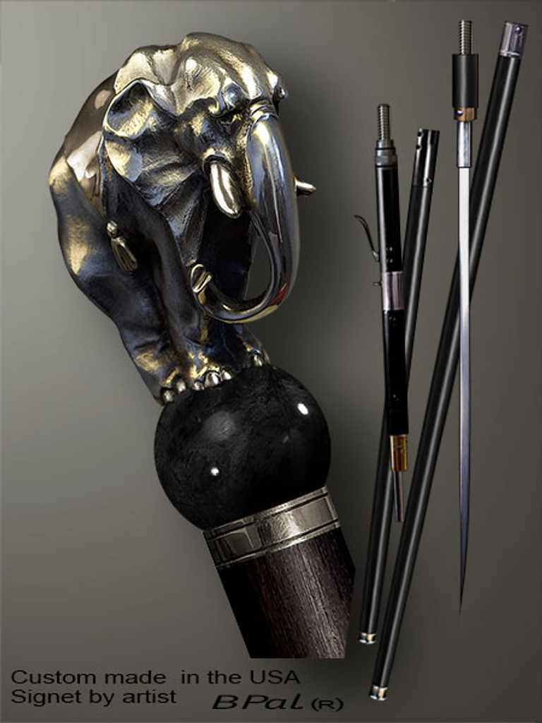 Artistic walking cane Elephant is created and produced in the USA. Designer walking sticks handle is cast from sterling silver and mounted on the ebony or rosewood shaft. Custom version can be finished with 24K Gold trim and natural gems. Somebody using a walking stick might want not only physical support, but also some level of collectible or self-defense value. That is why a support walking canes can be done as a sword cane or cane gun. In this case high quality knife or air gun shooting mechanism will be built into the shaft as shown on the picture.