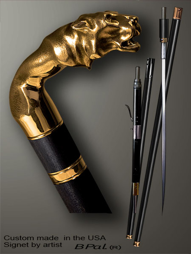 Exclusive walking cane Tiger is created and produced in the USA. Comfortable walking sticks handle is cast from bronze and mounted on the ebony shaft. Custom version can be finished with natural gems. Somebody using a walking stick might want not only physical support, but also some level of collectible or self-defense value. That is why a support walking canes can be done as a sword cane or cane gun. In this case high quality knife or air gun shooting mechanism will be built into the shaft as shown on the picture.