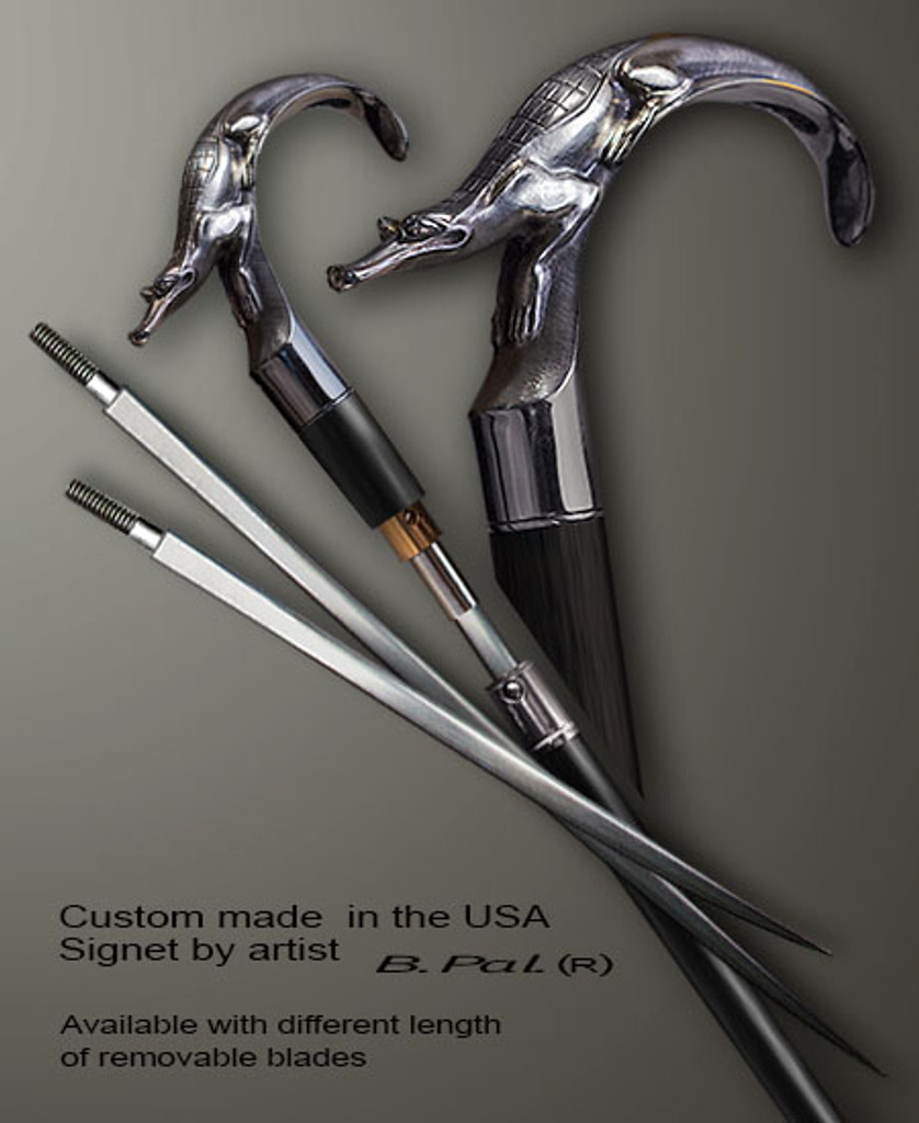 Sterling silver walking stick Alligator in sword cane version. Some regional laws prohibit the use of sword canes. That is why these sword canes are designed with removable blades. A sword canes tight opening telescopic mechanism provides the ability to load the cane as a regular support walking cane with or without the blade installed. The sword canes handle is cast from sterling silver and can be finished with 24K gold trim.