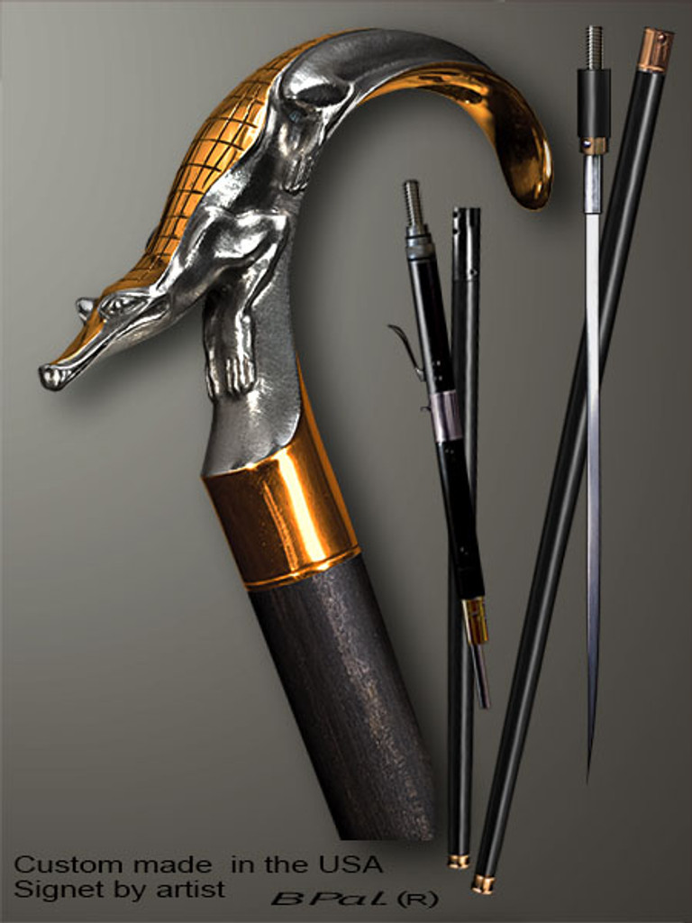 High end walking cane Alligator is created and produced in the USA. Handmade walking sticks handle is cast from sterling silver and mounted on the ebony or rosewood shaft. Custom version can be finished with 24K Gold trim. Somebody using a walking stick might want not only physical support, but also some level of collectible or self-defense value. That is why a support walking canes can be done as a sword cane or cane gun. In this case high quality knife or air gun shooting mechanism will be built into the shaft as shown on the picture.