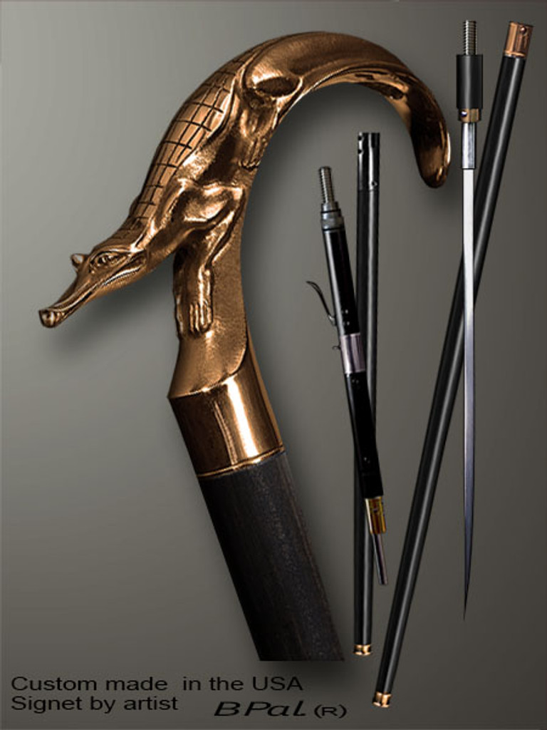 Custom walking cane Alligator is created and produced in the USA. Collectible walking sticks handle is cast from bronze and mounted on the ebony or rosewood shaft.  Somebody using a walking stick might want not only physical support, but also some level of collectible or self-defense value. That is why a support walking canes can be done as a sword cane or cane gun. In this case high quality knife or air gun shooting mechanism will be built into the shaft as shown on the picture.
