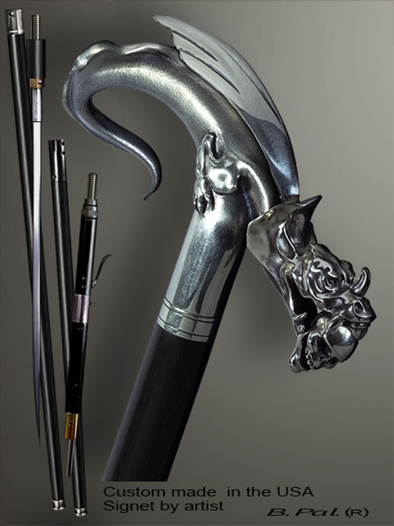 Exclusive walking cane Dragon with Skull in a jaws is created and produced in the USA. Somebody using a walking stick might want not only physical support, but also some level of collectible or self-defense value. That is why a support walking canes can be done as a sword cane or cane gun. In this case high quality knife or air gun shooting mechanism will be built into the shaft as shown on the picture. Artistic walking sticks handle is cast from sterling silver or bronze and mounted on the ebony or rosewood shaft. Custom version can be finished with natural gems.