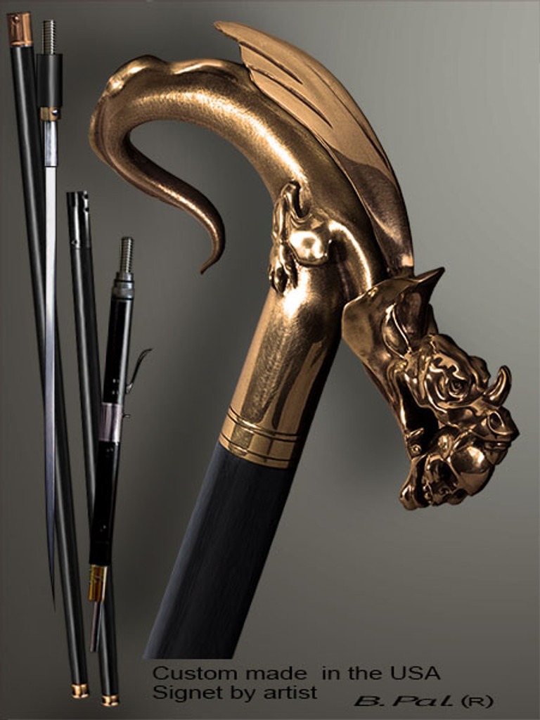 Collectible walking cane Dragon with Skull in a jaws is created and produced in the USA. Somebody using a walking stick might want not only physical support, but also some level of collectible or self-defense value. That is why a support walking canes can be done as a sword cane or cane gun. In this case high quality knife or air gun shooting mechanism will be built into the shaft as shown on the picture. Unique walking sticks handle is cast from bronze and mounted on the ebony or rosewood shaft. Custom version can be finished with natural gems.
