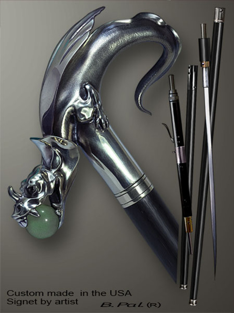 High end walking cane Dragon with Natural Jade Ball in Jaws is created and produced in the USA. Somebody using a walking stick might want not only physical support, but also some level of collectible or self-defense value. That is why a support walking canes can be done as a sword cane or cane gun. In this case high quality knife or air gun shooting mechanism will be built into the shaft as shown on the picture. Artistic walking sticks handle is cast from sterling silver or bronze and mounted on the ebony or rosewood shaft. Handmade version can be finished with natural gems.