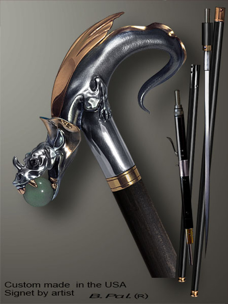 Functional and decorative walking cane Dragon with Natural Jade Ball in Jaws is created and produced in the USA. Somebody using a walking stick might want not only physical support, but also some level of collectible or self-defense value. That is why a support walking canes can be done as a sword cane or cane gun. In this case high quality knife or air gun shooting mechanism will be built into the shaft as shown on the picture. Luxury walking sticks handle is cast from sterling silver or bronze and mounted on the ebony or rosewood shaft. Handmade version can be finished with 24K Gold trim and natural gems.