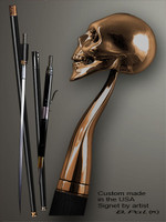 Custom made walking cane Skull is created and produced in the USA. Luxury walking sticks handle is cast from bronze and mounted on the ebony or rosewood shaft. Custom version can be finished with natural gems. Somebody using a walking stick might want not only physical support, but also some level of collectible or self-defense value. That is why a support walking canes can be done as a sword cane or cane gun. In this case high quality knife or air gun shooting mechanism will be built into the shaft as shown on the picture.