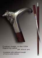 Functional and decorative walking cane Wolf is created and produced in the USA. Handmade walking sticks handle is cast from sterling silver or bronze and mounted on the rosewood shaft. Custom version can be finished with natural gems. Somebody using a walking stick might want not only physical support, but also some level of collectible or self-defense value. That is why a support walking canes can be done as a sword cane. In this case high quality knife will be built into the shaft as shown on the picture.