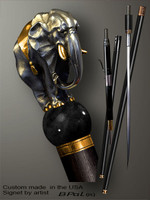 Unique walking cane Elephant is created and produced in the USA. Artistic walking sticks handle is cast from sterling silver and mounted on the ebony shaft. Custom version can be finished with 24K Gold trim and natural gems. Somebody using a walking stick might want not only physical support, but also some level of collectible or self-defense value. That is why a support walking canes can be done as a sword cane or cane gun. In this case high quality knife or air gun shooting mechanism will be built into the shaft as shown on the picture.