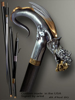 Designer walking cane Dragon with Skull in a jaws is created and produced in the USA. Somebody using a walking stick might want not only physical support, but also some level of collectible or self-defense value. That is why a support walking canes can be done as a sword cane or cane gun. In this case high quality knife or air gun shooting mechanism will be built into the shaft as shown on the picture. Luxury walking sticks handle is cast from sterling silver or bronze and mounted on the ebony or rosewood shaft. Custom version can be finished with 24K Gold trim and natural gems.