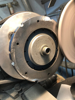 Cylindrically grind Horstman axle clutch pressure plate