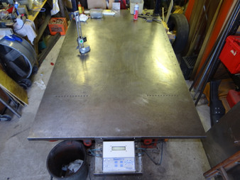 "We use a 54"" x 96"" flat steel (5500#) table to perform any chassis set-up work"