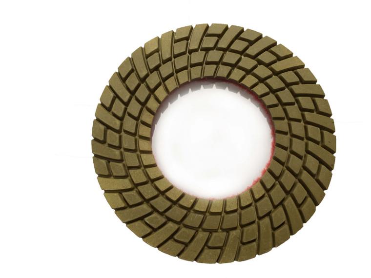 Worx+ Halo resin pad for edge work in concrete polishing.