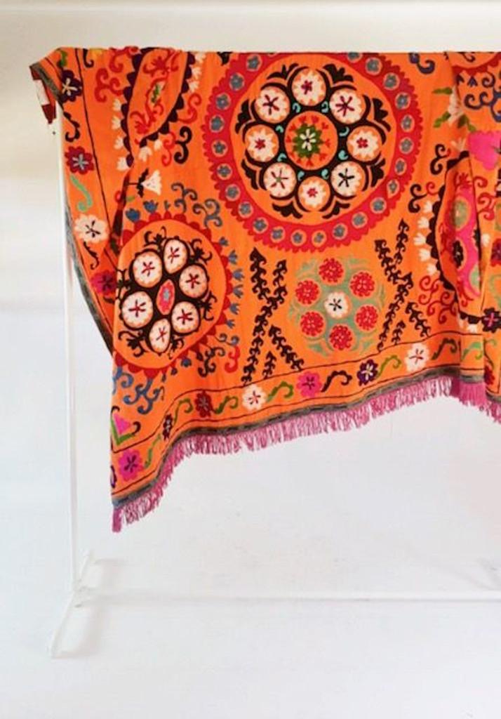 Orange medallion Suzani with purple fringe