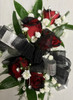 Black tipped red sweetheart Corsage