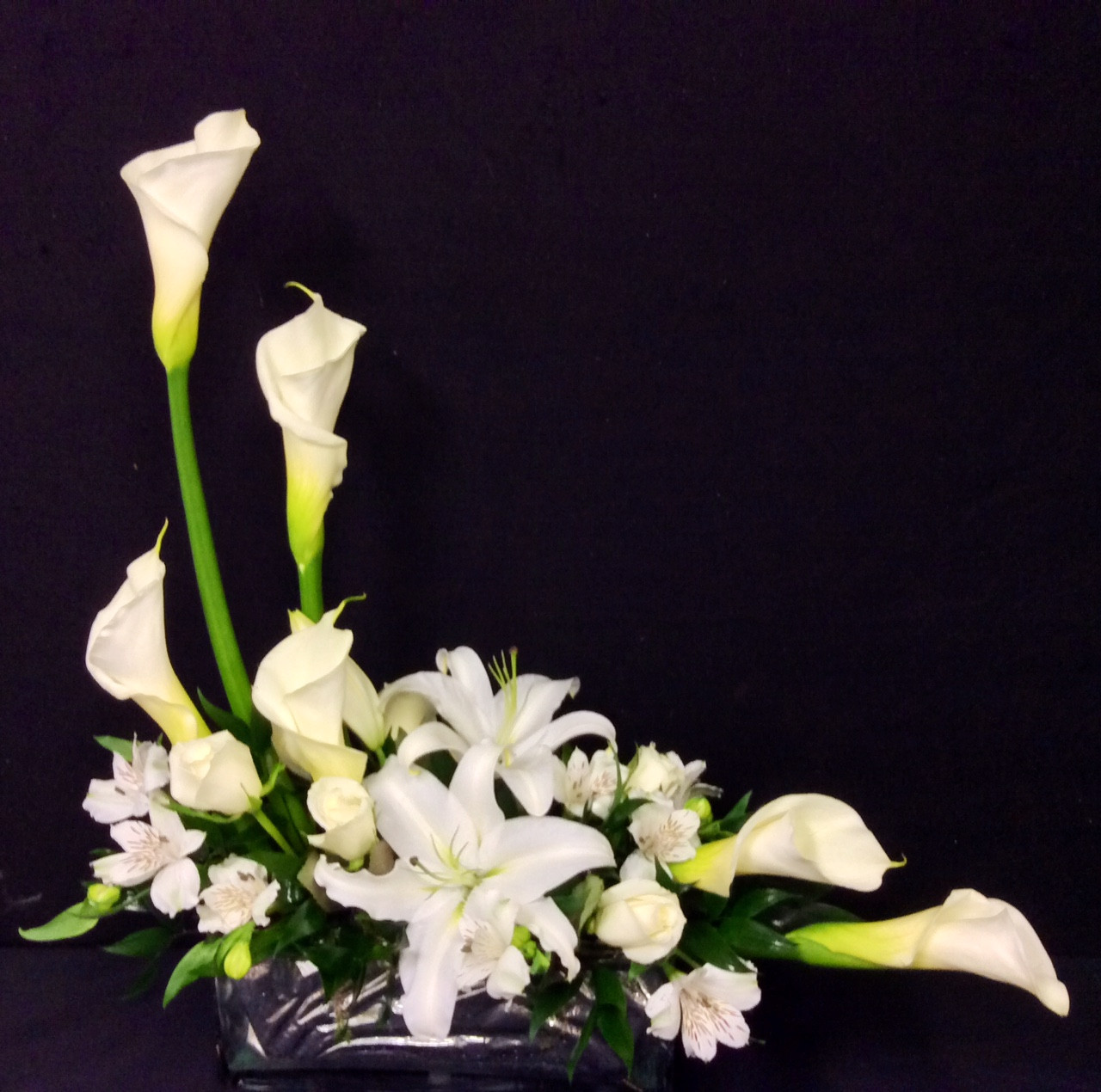 Contemporary Arrangement With Calla Lilies And White Stargazers Centerville Florists