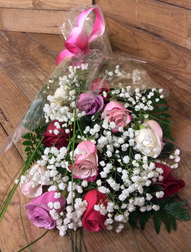 Dozen Mixed Colored Ecuadorean Roses Wrapped with Greenery and Filler