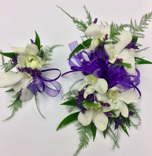 White orchid and limonium wristlette and boutonnière combo