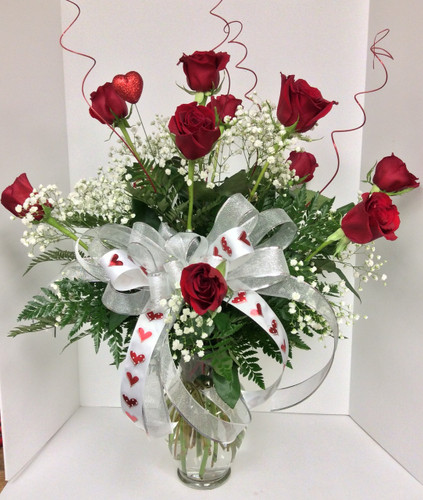 Dozen long stemmed premium Ecuadorean freedom red roses with Valentine's trim