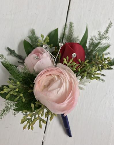 Rose and ranunculus boutonnière